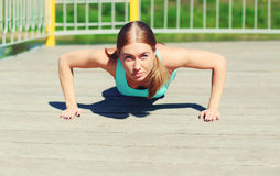 Sport and fitness concept - woman doing push-ups exercise Royalty Free Stock Photo