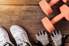 Sport and fitness concept on wooden. Planks background. Top View stock photos