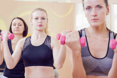 Sport and Fitness Concepts. Three Attractive and Positive Caucasian Females Having a Workout Training Royalty Free Stock Photo