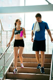 Sport fitness couple down stairs after training Stock Photo