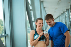 Sport fitness couple relaxing after training in modern interior Stock Photo