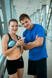 Sport fitness couple relaxing after training in modern interior Royalty Free Stock Photos