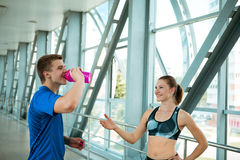 Sport fitness couple relaxing after training in modern interior Royalty Free Stock Photography
