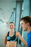 Sport fitness couple relaxing after training in modern interior Stock Image