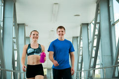 Sport fitness couple walking in modern interior after training Stock Images