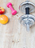 Sport fitness diet concept weights dumbbell and fruit Stock Image