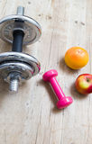 Sport fitness diet concept weights dumbbell and fruit Royalty Free Stock Images