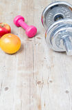 Sport fitness diet concept weights dumbbell and fruit Stock Photography