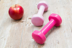 Sport fitness diet concept weights dumbbell and fruit Stock Images