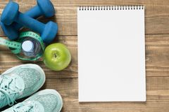 Sport and fitness equipment, creative flat lay on wooden board. Empty blank with space for you. Top view Stock Images