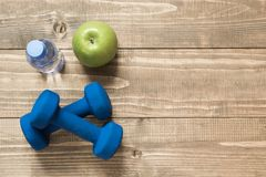 Sport and fitness equipment, creative flat lay on wooden board. Space for you. Flat lay Stock Photography