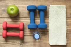 Sport and fitness equipment, creative flat lay on wooden board. Space for you. Flat lay Royalty Free Stock Images