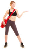 Sport. Fitness girl with gym bag showing copy space Stock Photos