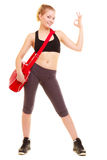 Sport. Fitness girl with gym bag showing ok hand sign Royalty Free Stock Photos