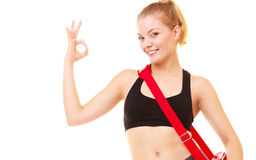 Sport. Fitness girl with gym bag showing ok hand sign Stock Photo
