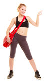Sport. Fitness girl with gym bag showing ok hand sign Stock Photos