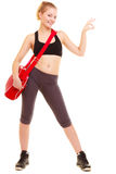 Sport. Fitness girl with gym bag showing ok hand sign Royalty Free Stock Image
