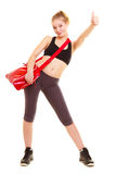 Sport. Fitness girl with gym bag showing thumb up Royalty Free Stock Images