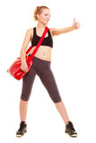 Sport. Fitness girl with gym bag showing thumb up Royalty Free Stock Photos