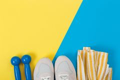 Shoes and sports equipment on yellow floor. concept stock image