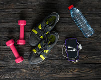 Sport fitness items on dark wooden background Stock Photo