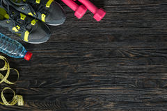 Sport fitness items on dark wooden background. With empty text space royalty free stock photo