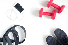 Sport fitness items with smartphone on white background, flat la. Y, top view, copy space stock photography