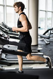Sport, fitness, lifestyle, technology and people concept - smiling man exercising on treadmill in gym stock photo