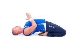 Sport fitness man doing yoga exercise Royalty Free Stock Image