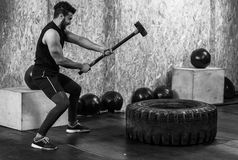 Sport Fitness Man Hitting Wheel Tire With Hammer Sledge Crossfit Training, Young Healthy Guy Royalty Free Stock Photos