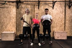 Sport Fitness People Group Crossfit Training Equipment, Young Healthy Man And Woman Gym Interior Doing Exercises stock images