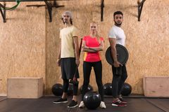 Sport Fitness People Group Crossfit Training Equipment, Young Healthy Man And Woman Gym Interior Doing Exercises stock photos