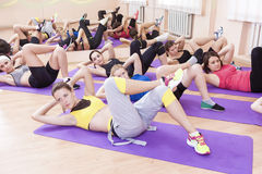 Sport, Fitness and Pilates Concepts. Group of Seven Caucasian Females Stretching Stock Photography