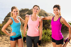 Sport fitness portrait of three beautiful ladies women athletes outdoors in nature on a jog hike Royalty Free Stock Photo