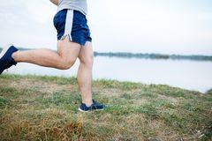 Sport and fitness runner man doing outdoors training for marathon run. royalty free stock photography