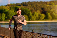Sport and fitness runner man running in the park stock image