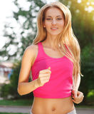 Sport fitness running woman jogging during outdoor workout stock photo