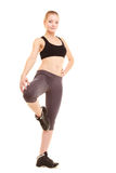 Sport. fitness sporty blonde girl stretching leg isolated Royalty Free Stock Photo