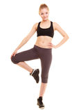 Sport. fitness sporty blonde girl stretching leg isolated Royalty Free Stock Photos