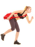 Sport. Fitness sporty girl with gym bag running to training Royalty Free Stock Images