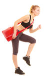 Sport. Fitness sporty girl with gym bag running to training Royalty Free Stock Photos