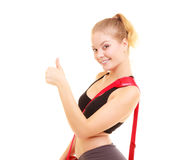 Sport. Fitness sporty girl with gym bag showing thumb up Stock Photos