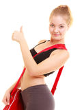 Sport. Fitness sporty girl with gym bag showing thumb up Royalty Free Stock Images