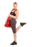 Sport. Fitness sporty girl in sportswear with gym bag Stock Photography