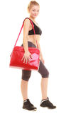 Sport. Fitness sporty girl in sportswear with gym bag Royalty Free Stock Images
