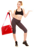 Sport. Fitness sporty girl in sportswear showing copy space Stock Photography