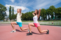 Sport and fitness. Summer activity and energy. Coach and health. Man and women sunny outdoor on blue sky. Couple workout and stretching royalty free stock photography