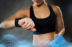 Woman with heart-rate watch in gym Royalty Free Stock Photography
