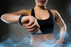 Woman with heart-rate watch in gym Royalty Free Stock Photo