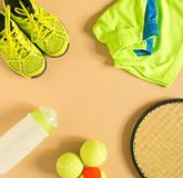 Sport, fitness, tennis, healthy lifestyle, sport stuff. Tennis racket, lime trainers, tennis ball, lime athletic shorts, sports bo Stock Images